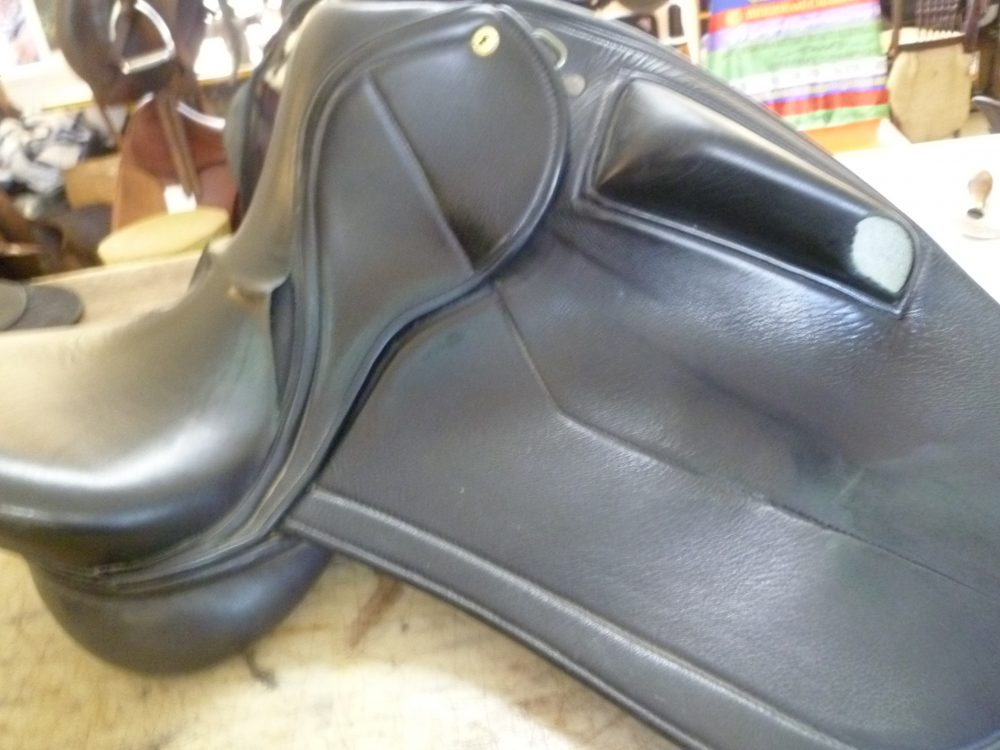 Black Dressage Saddle before restoration